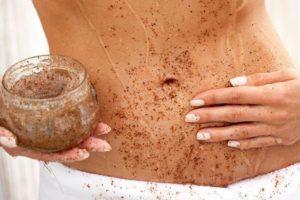 Woman-applying-body-scrub